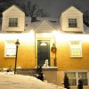 Christmas Lights on Yellow House
