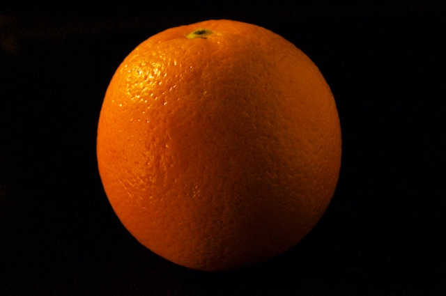 Light box studio photograph of an orange