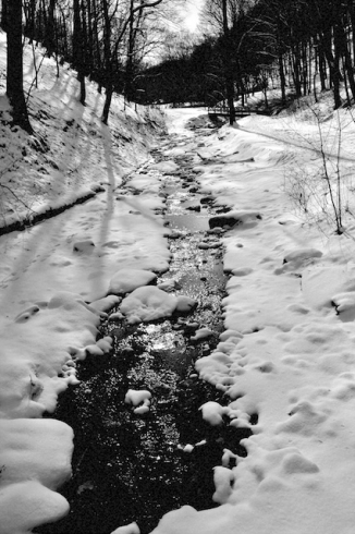 Snowy creek in black and ahite