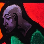 Stained glass depicting a presumably African-American character from Stephen Foster's songs, close-up of head