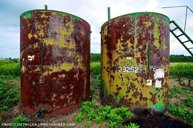 Rusty Oil Tanks in Cornfield