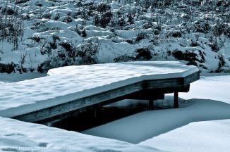 Snow on Dock on frozen pond